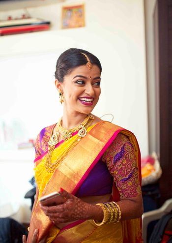 South Indian Bride in Yellow and Purple Saree