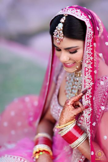 bride in bright pink lehenga