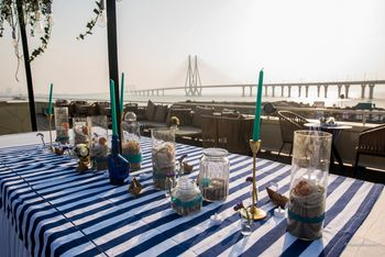 A pretty table setting by the beach perfect for an intimate sundowner