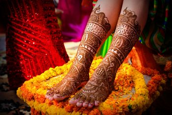 A beautiful bridal feet mehndi design.