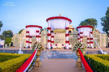 Photo of Red and white theme mandap