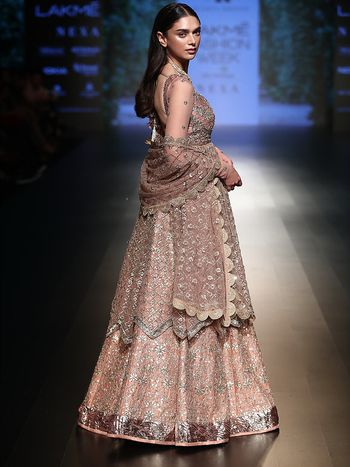 Photo of rose gold modern lehenga with a scalloped border