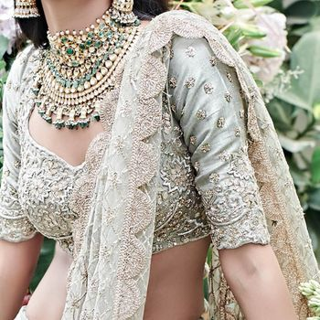 Photo of sage blouse with heavy green bridal set