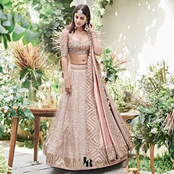 Photo of pastel pink engagement lehenga with modern look by jayanti reddy