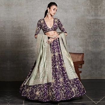 embroidered purple lehenga for reception with heavy work
