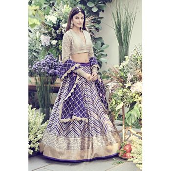 Photo of purple banarasi lehenga for sangeet or reception