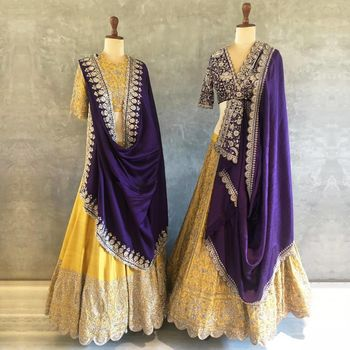 Vibrant yellow lehenga with contrasting purple dupatta.