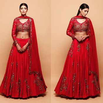Photo of Vibrant red & gold lehenga for friends of the bride or groom.Perfect for a fun filled cocktail night.