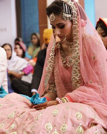 Photo of A beautiful bridal portrait of a bride during anand karaj