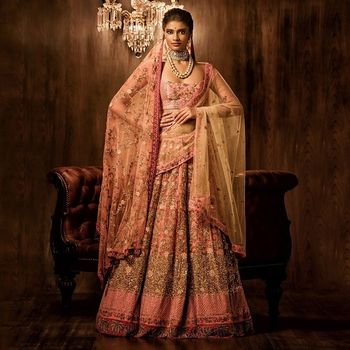Photo of light pink bridal lehenga