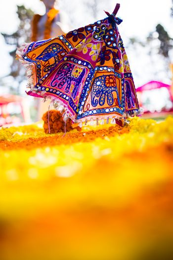Photo of Rajasthani umbrella mehendi decor