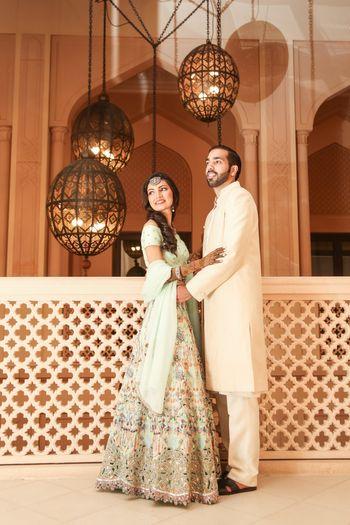 Photo of Fort couple portrait with pastel lehenga