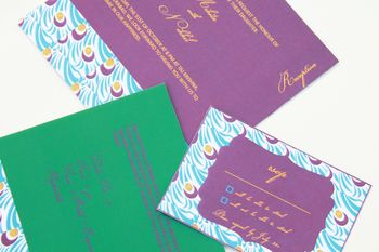 Photo of purple and green moroccan theme invitation cards