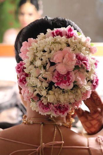 A floral bridal bun