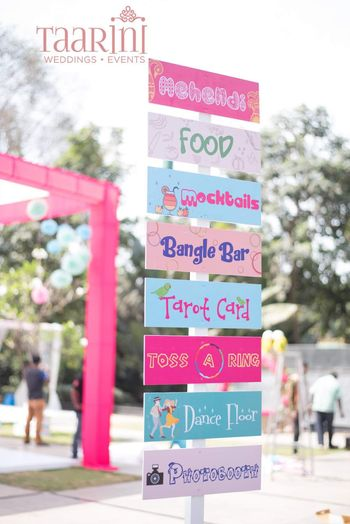 Photo of Fun and quirky signboards for mehndi function.