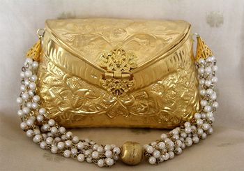 Photo of Gold metallic bridal clutch