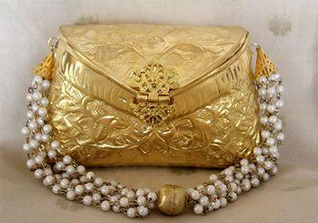 Photo of Gold metallic bridal clutch