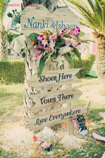 Photo of Wooden Arrow Boards for Wedding Decor