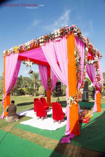 Photo of Pink and Orange Mandap Decor