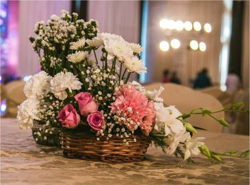 Photo of Pink and White Floral Basket Table Centerpiece