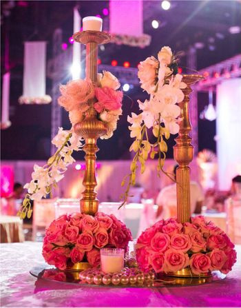 Photo of Gold Candelabras and Floral Centerpiece