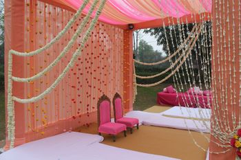 peach and bright pink mandap decor