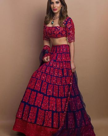 Fully embellished red and navy blue lehenga.