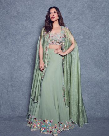 This light green lehenga with cape style dupatta fits well for a pooja ceremony.