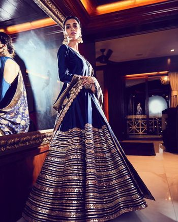 Monotone anarkali with banarasi dupatta and gold detailing.