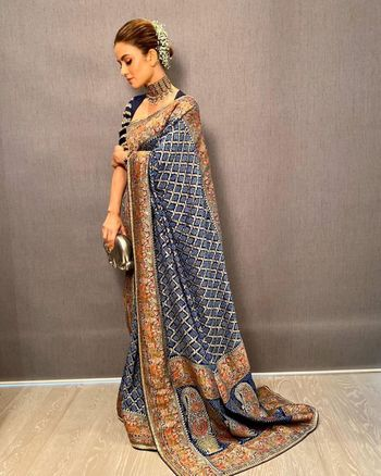 Photo of Heavy banarasi blue and gold saree great for a Reception.