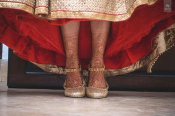 Bride Wearing Gold Shoes and Anklets