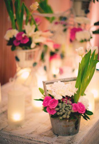 Floral arrangement in rustic tin basket
