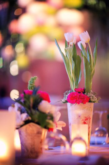 Photo of Vintage glass with tulips as centerpiece