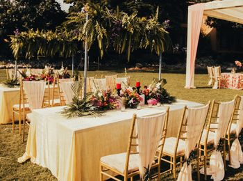 Photo of long table seating idea for an intimate wedding with florals