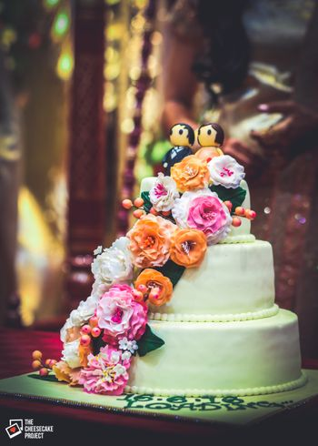 3 Tier Wedding Cake with Couple Models and Floral Decor