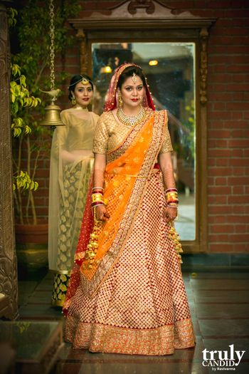 Red and gold bridal lehenga with yellow dupatta