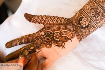 Bridal Hand Mehendi - Floral Bel Design