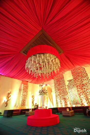 Photo of Red Canopy and Yellow Floral Chandeliers