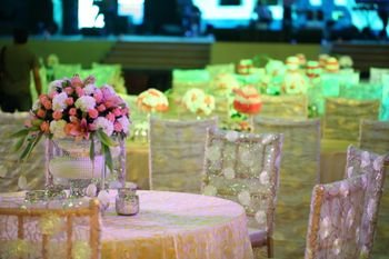 Photo of White Floral Seating with Floral Centerpiece