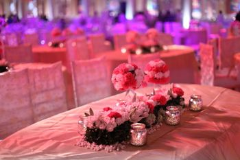 Photo of White and Red Floral Centerpiece with Candles