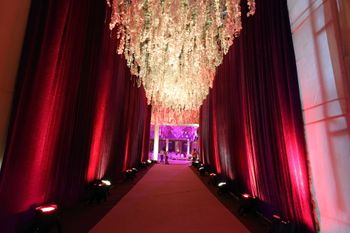 Photo of Marsala Themed Entrance with Floral Decor