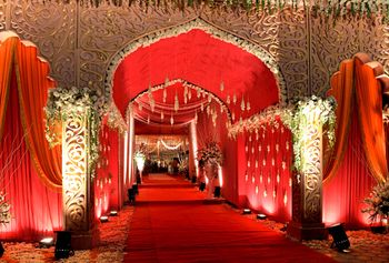Photo of Red Themed Mandap with Floral Decor