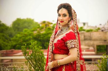 Bride in Red Lehenga and Gold Nath