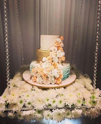 A beautiful three tier designer wedding cake.