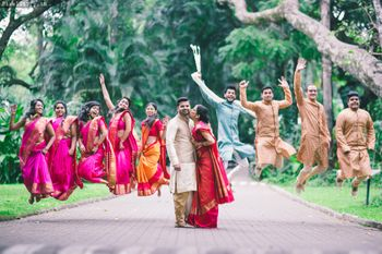 Photo of south indian fun bridesmaids and grooms men portrait