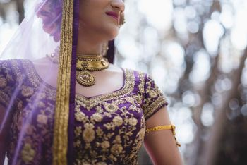 Offbeat bridal blouse in purple colour