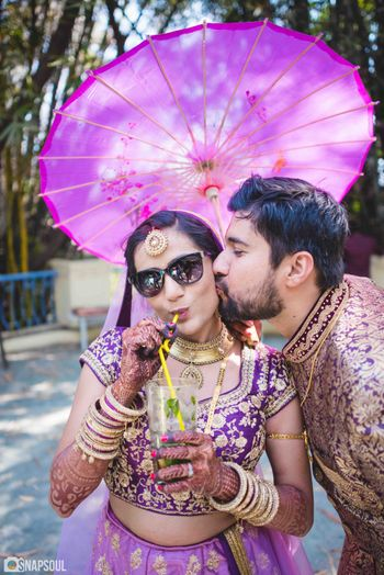 Cool couple portrait with bride drinking alcohol