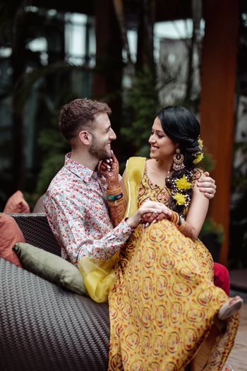 Candid shot of a happy couple from their Mehndi