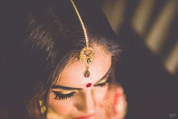 Photo of Gold Maangtikka with Ruby Drops