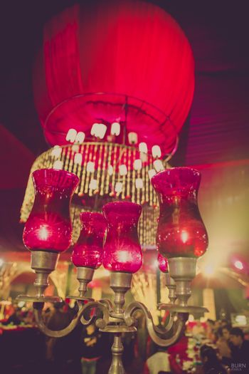 Photo of Gold and Red Lamp Candelabras
